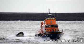Man in sinking boat rescued after drifting two miles out to sea