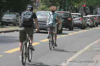 Rétropédalage sur la piste cyclable temporaire entre Le Pecq et Chatou - Le Parisien