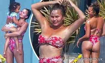 Chrissy Teigen wears bikini after breast implant removal
