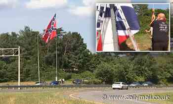 Huge confederate flag is flown from an 80-foot pole over North Carolina highway over statue removals