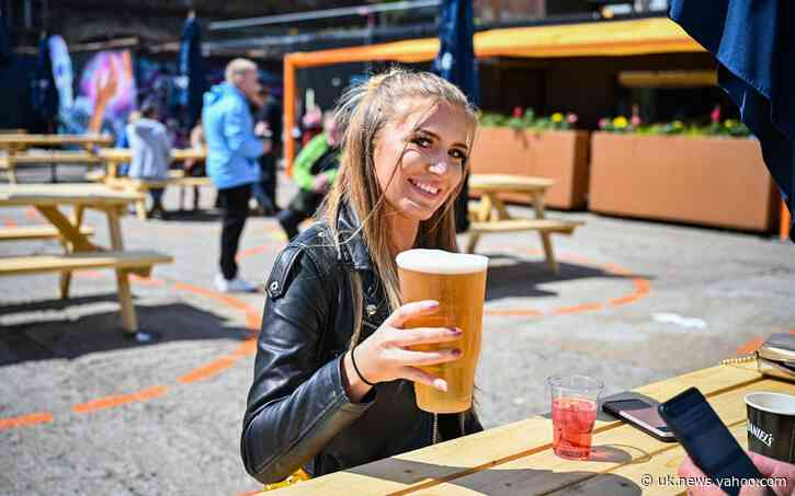 Scots wait an hour for a pint as beer gardens finally reopen