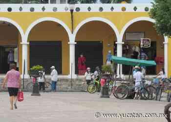 Una calesa y poca gente en el centro de Izamal - El Diario de Yucatán