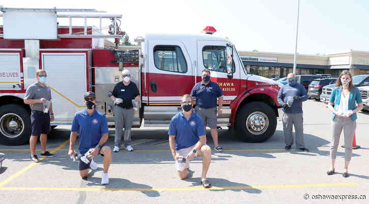 Firefighters hand out masks, soap to residents