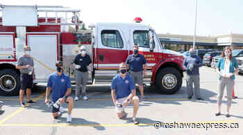 Firefighters hand out masks, soap to residents - Oshawa Express