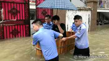 Police use bathtub as boat to transport students for Gaokao - CGTN
