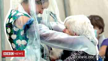 Coronavirus: Care home installs 'cuddle curtain' for families
