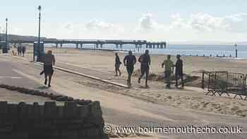 WBC heavyweight champion Tyson Fury spotted jogging on Bournemouth beach