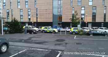 Armed police race to Glasgow flats after 'ongoing incident' in West End - Daily Record