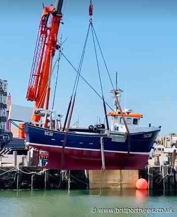 Baboo Gelato team watch boat being lifted into West Bay harbour - Bridport and Lyme Regis News
