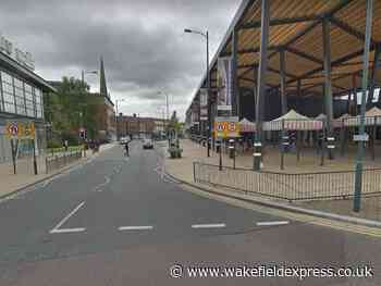 Cyclist left trapped under bus in Wakefield city centre - Wakefield Express