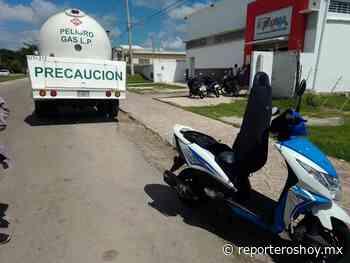 Operador de una gasera arrastra una moto en Izamal - Reporteros Hoy