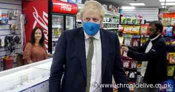 Boris Johnson hints face masks could become mandatory in shops in England