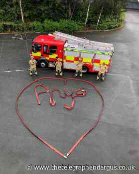 Firefighters spell out a young fan's name using hose reels