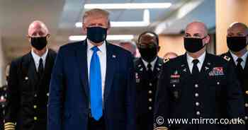 Trump wears mask for first time after saying Covid-19 'would disappear'