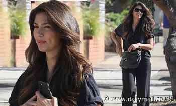 Pia Miller looks effortlessly chic in wide-leg trousers as she enjoys a stroll in Sydney