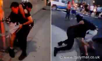 NYPD officer is placed into a headlock by 'known gang member' in the Bronx