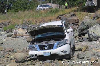 PHOTOS: Vehicle crashes down North Saanich embankment, onto Patricia Bay shore - Victoria News