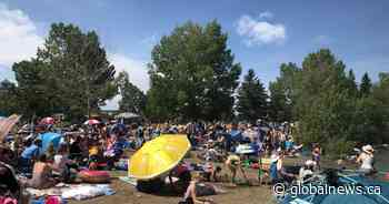 Beachgoers crowd Sylvan Lake despite pandemic rules: 'COVID-19 is still here'