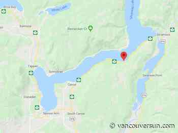 Hitchhiker holding metal pipe holds up Highway 1 near Salmon Arm