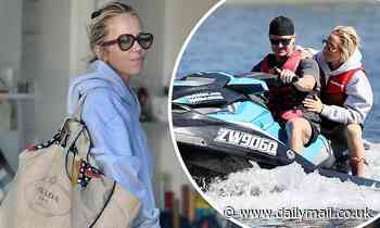 Pip Edwards clutches onto cricketer boyfriend Michael Clarke as they go jetskiing together in Noosa