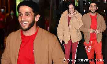 Firass Dirani is all smiles as he enjoys a night out in Sydney with a mystery brunette beauty