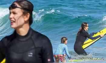 Jennifer Garner splashes in the Malibu surf wearing a wetsuit during swim outing with her son Samuel