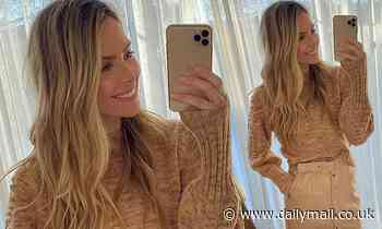 Jennifer Hawkins shows off her glamorous winter outfit