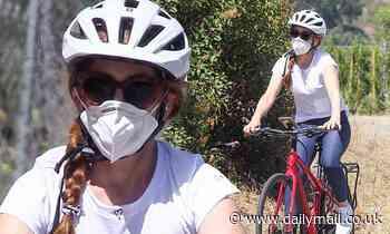 Isla Fisher wears a face mask as she enjoys a bike ride in LA