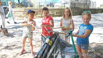 Kinder sammeln Müll an der Nidda - Wetterauer Zeitung