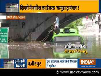 Bus half submeged in waterlogged road under Minto Bridge following downpour in Delhi - India TV News