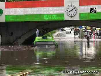 Watch: Bus half submeged in waterlogged road under Minto Bridge following downpour in Delhi - Yahoo India News