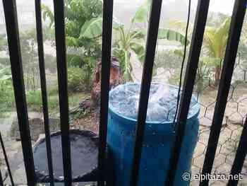 En Los Olivos de Charallave aprovechan la lluvia para recoger agua - El Pitazo