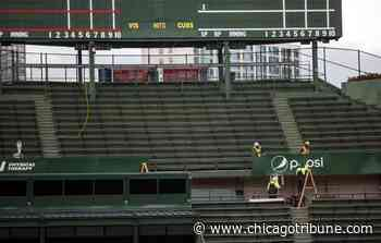 Chicago Cubs cover Wrigley Field bleachers with ads - Chicago Tribune