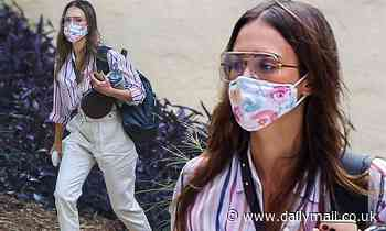 Jessica Alba means business as she heads to the office armed with a floral print face mask