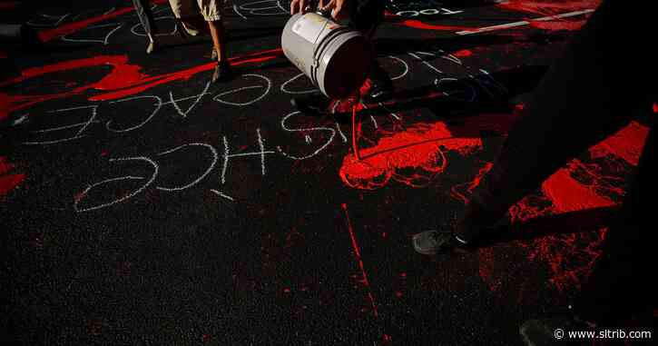 Three more protesters charged with painting Salt Lake County District Attorney's office red