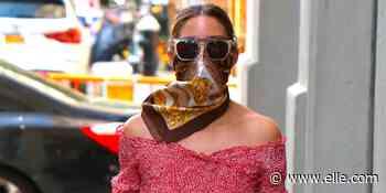 Olivia Palermo repite su conjunto de top y falda midi un mes después con mules y bolso blanco - elle.com