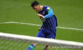 Cardiff battle QPR and Millwall for Wigan striker Kieffer Moore with £2.1m bid