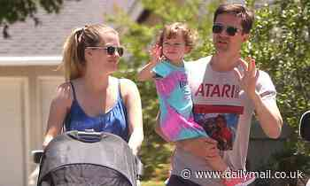 Topher Grace and Ashley Hinshaw spotted pushing baby stroller while out walking