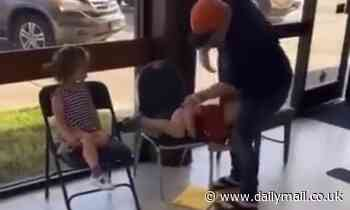 Video of man spanking a little boy and yelling 'sit your a** down' to a girl sparks outrage