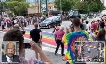 Crowd erupts into applause as hearse carrying John Lewis pauses in Atlanta's rainbow crosswalks