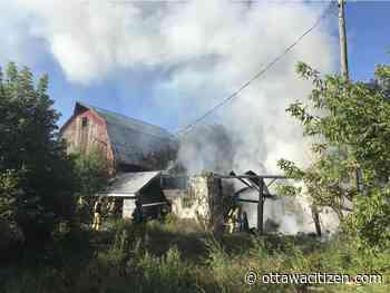 Firefighters escape roof collapse in barn fire on Fallowfield Road