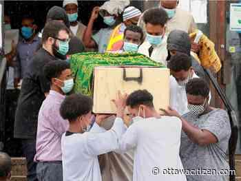 Hundreds gather to mourn slain Mohamed Hassan