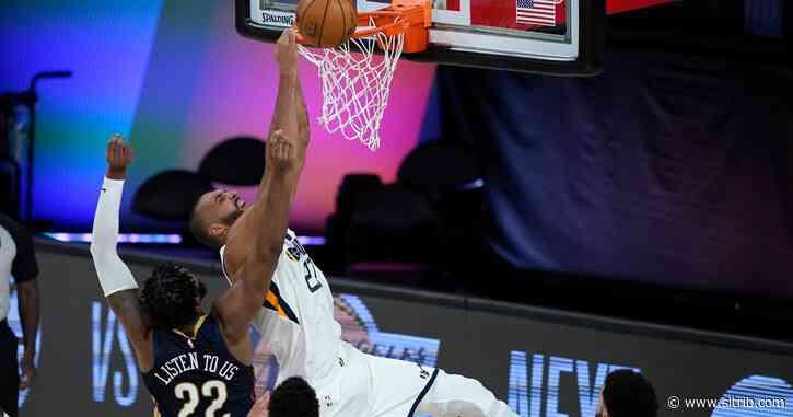 Donovan Mitchell and Rudy Gobert team up to lead Utah Jazz's 106-104 win in NBA season restart