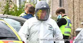 Paramedics in hazmat suits at house in Grimsby as police and ambulance on scene - Grimsby Live