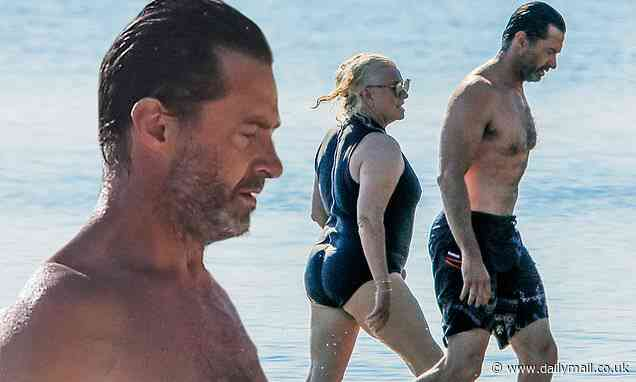 Hugh Jackman shows off his muscular physique while hitting the beach in the Hamptons with his wife - Daily Mail