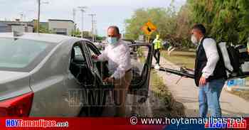 Tamaulipas Covid-19 Desinfectan vehculos en Arboledas en Matamoros - Hoy Tamaulipas