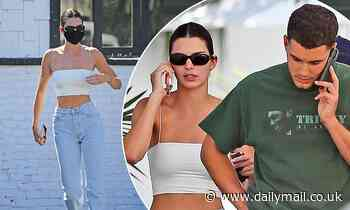 Kendall Jenner flashes her torso as she watches the Phoenix Suns game with pals