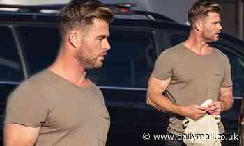 Chris Hemsworth displays his bulging biceps in a tight T-shirt while shopping in Byron Bay