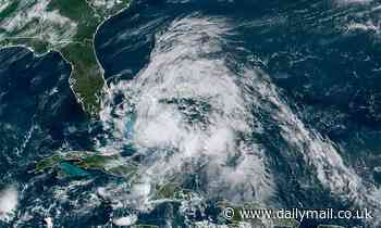 Isaias is downgraded to a tropical storm as it tears across the Bahamas with Florida bracing