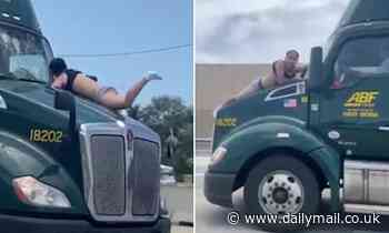 Florida man is filmed clinging to the hood of a semi truck driving down an interstate for NINE MILES